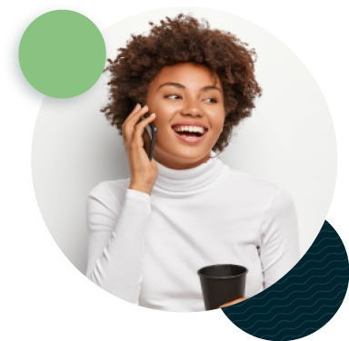 smiling person talking on cell phone